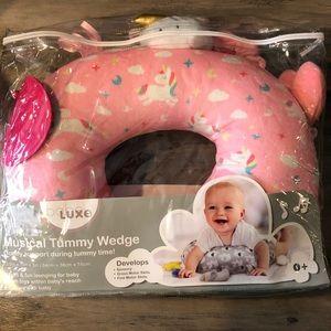 Infant musical tummy wedge